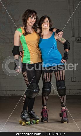 Roller Derby Skater Friends stock photo, Pair of Caucasian female roller derby skater friends by Scott Griessel