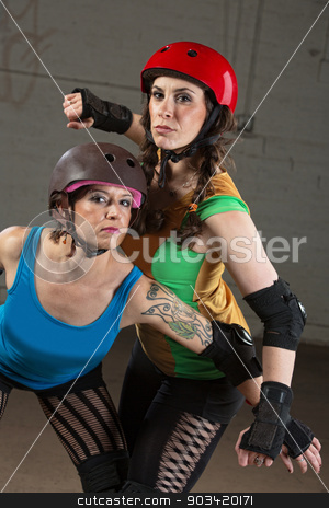Female Roller Derby Skaters stock photo, Pretty roller derby skater with tattoo and partner posing by Scott Griessel