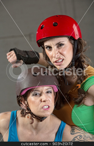 Threatening Roller Derby Skaters stock photo, Two tough female roller derby skaters with clenched teeth by Scott Griessel