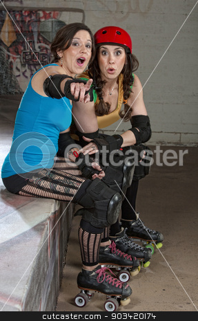 Female Roller Derby Skaters stock photo, Pair of European female roller derby skaters as spectators by Scott Griessel