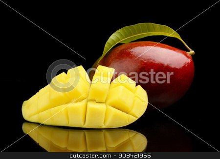 Ripe mango with slice and leaf isolated black background stock photo, Close-up studio shot mango fruit with slice and leaf isolated on black background  by Tadeusz Wejkszo