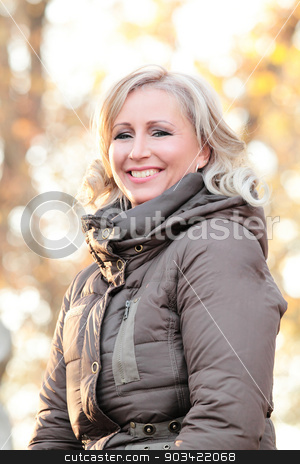 Blond woman stock photo, Portrait of a blond woman in autumn by Nneirda