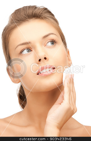beautiful woman with cotton pad stock photo, bright closeup portrait picture of beautiful woman with cotton pad by Syda Productions