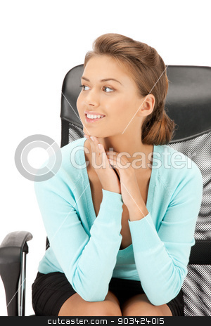 young businesswoman sitting in chair stock photo, picture of young businesswoman sitting in chair by Syda Productions