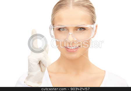 woman in protective glasses and gloves stock photo, picture of woman in protective glasses and gloves by Syda Productions