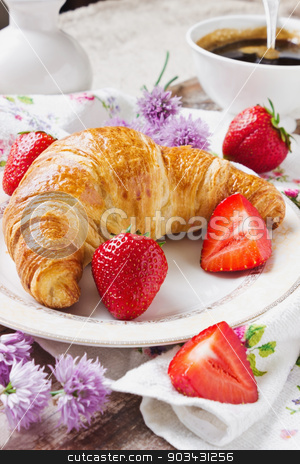 traditional breakfast stock photo, crispy croissant and strawberries in a plate.selective focus. by Jevgeni Proshin