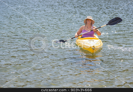 Woman Kayaking on Beautiful Mountain Lake. stock photo, Woman Kayaking on Beautiful Peaceful Mountain Lake. by Andy Dean
