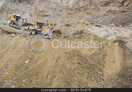 Excavator Tractors Moving Dirt stock photo, Two Excavator Tractors Moving Dirt. by Andy Dean