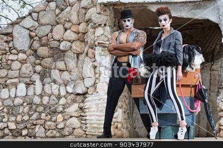 Surreal Circus Performers stock photo, Pair of comedia del arte performers in hat and striped pants by Scott Griessel