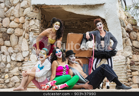 Laughing Cirque Ensemble stock photo, Lauging ensemble of bizarre circus clowns on stage by Scott Griessel