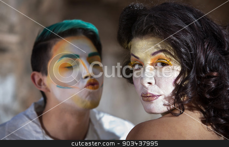 Clown Trying to Kiss Woman stock photo, Clown trying to kiss pretty woman in cirque performance by Scott Griessel