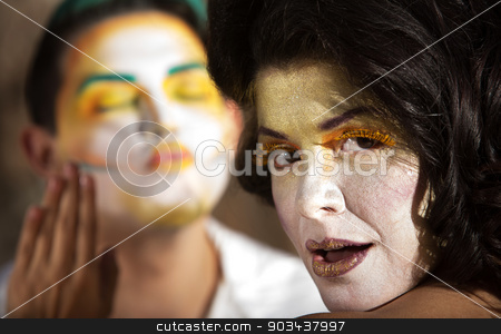 Modest Clown Dismissing Admirerer stock photo, Modest young woman as clown rejecting kissing man by Scott Griessel