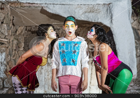Women with Blushing Cirque Clown stock photo, Surprised young cirque clown with females blowing kisses by Scott Griessel