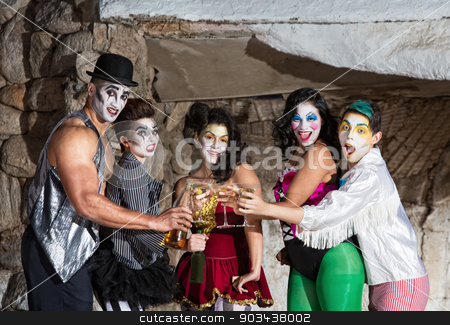 Cirque Clowns with Martinis stock photo, Martini drinking cirque clown ensemble toasting on stage by Scott Griessel