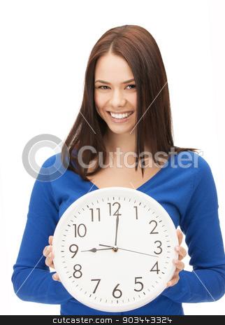 woman holding big clock stock photo, bright picture of woman holding big clock by Syda Productions