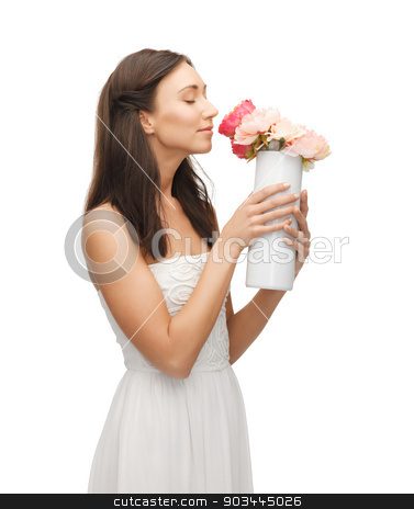 woman with vase of flowers stock photo, young and beautiful woman with vase of flowers by Syda Productions