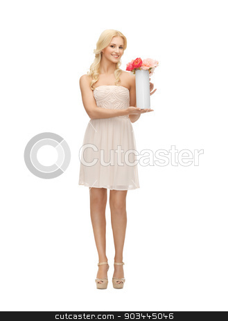 woman with vase and flowers stock photo, young and beautiful woman with vase and flowers by Syda Productions