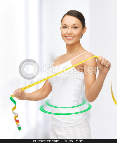 sporty woman with measuring tape stock photo, picture of sporty woman with measuring tape by Syda Productions