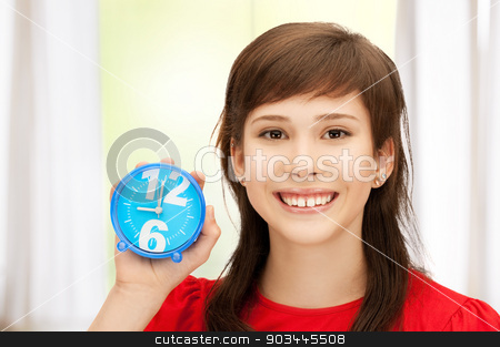 teenage girl holding alarm clock stock photo, bright picture of teenage girl holding alarm clock by Syda Productions