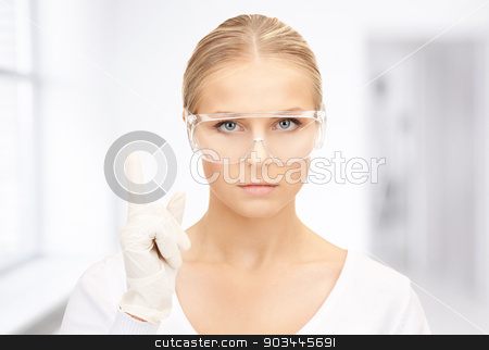 woman in protective glasses and gloves stock photo, bright picture of woman in protective glasses and gloves by Syda Productions