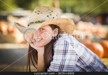 Pretty Preteen Girl Portrait at the Pumpkin Patch stock photo, Pretty Preteen Girl Wearing Cowboy Hat Portrait at the Pumpkin Patch in a Rustic Setting. by Andy Dean