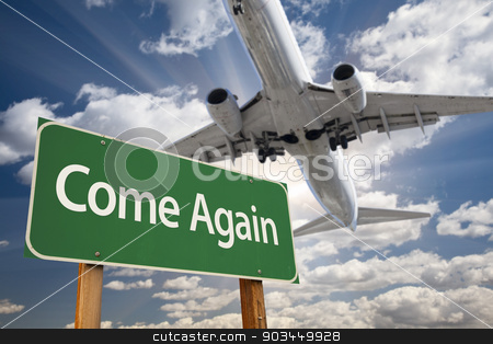 Come Again Green Road Sign and Airplane Above stock photo, Come Again Green Road Sign and Airplane Above with Dramatic Blue Sky and Clouds. by Andy Dean