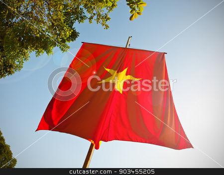 Vietnam flag stock photo, Vietnam flag with lens flare. by Pablo Caridad