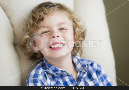 Cute Blonde Boy Smiling Sitting in Chair stock photo, Cute Blonde Boy Smiling for Portrait Sitting in Chair. by Andy Dean