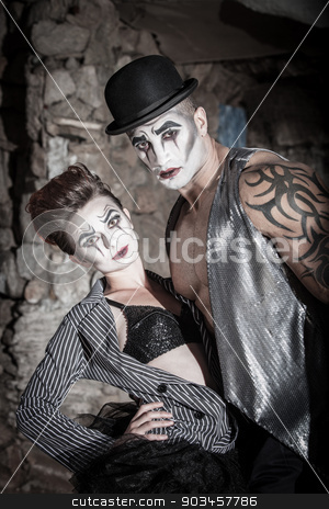 Dramatic Cirque Couple stock photo, Strong and beautiful comedia del art performers by Scott Griessel