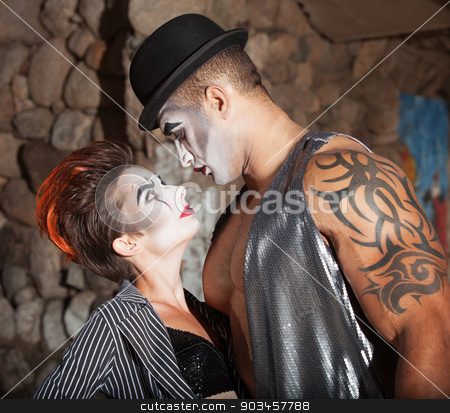 Beautiful Cirque Lovers stock photo, Muscular cirque performer looking at his beautiful partner by Scott Griessel