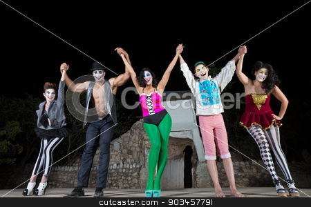 Happy Actors Celebrating stock photo, Group of happy clowns holding hands and celebrating by Scott Griessel