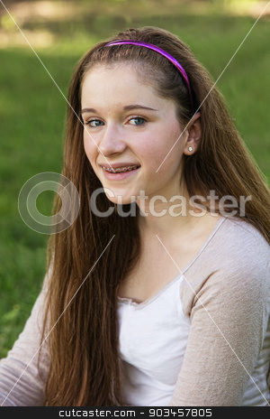 Smiling Teen Girl stock photo, Smiling teenage white female with braces on teeth by Scott Griessel