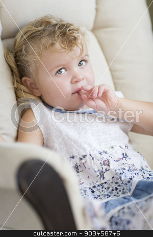 Adorable Blonde Haired and Blue Eyed Little Girl in Chair stock photo, Adorable Blonde Haired and Blue Eyed Little Girl Sitting in Chair. by Andy Dean