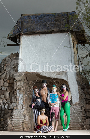 Circus Performers in Outdoor Stage stock photo, Circus ensemble posing at outdoor stone stage by Scott Griessel