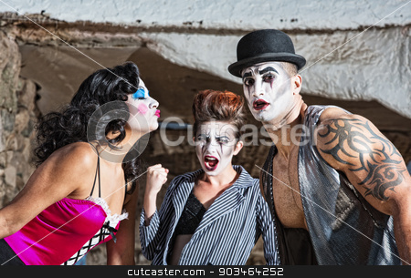 Mad Love Triangle stock photo, Cirqe ensemble love triangle with mad woman clenching fist by Scott Griessel