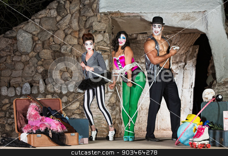 Clowns Tying Up Woman stock photo, Funny cirque clowns tying up woman with rope by Scott Griessel