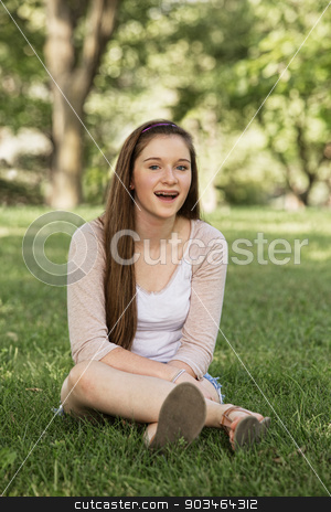 Laughing Teen Girl stock photo, Laughing teen girl with braces sitting outside by Scott Griessel