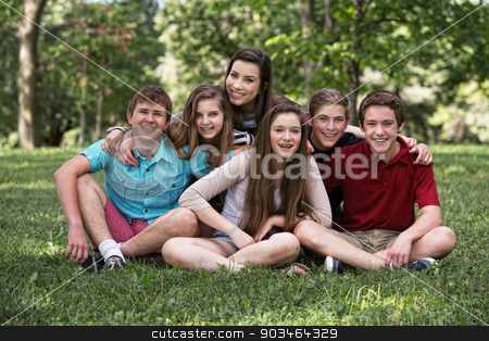 Happy Teen Boys and Girls stock photo, Teen boys and girls sitting on grass outdoors by Scott Griessel