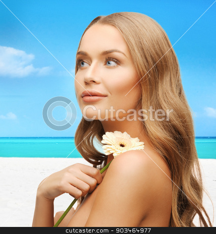 lovely woman with gerbera flower stock photo, bright picture of lovely woman with gerbera flower by Syda Productions
