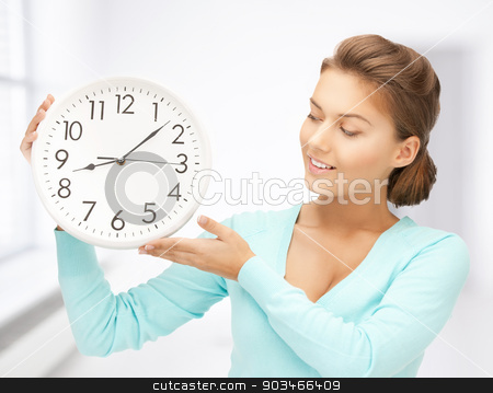 woman with wall clock stock photo, attractive woman holding wall clock in her hands by Syda Productions