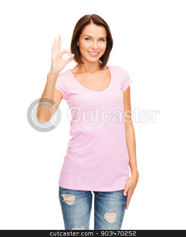 woman in blank pink t-shirt showing ok gesture stock photo, happy people concept - smiling woman in blank pink t-shirt showing ok gesture by Syda Productions