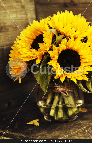 sunflowers stock photo, Beautiful fresh  Sunflowers in vase on wooden background by klenova