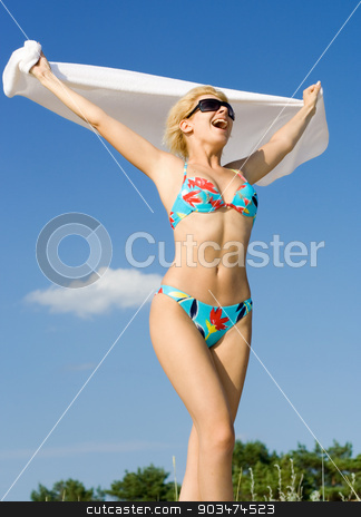 freedom stock photo, pretty blond in bikini screaming on the beach by Syda Productions