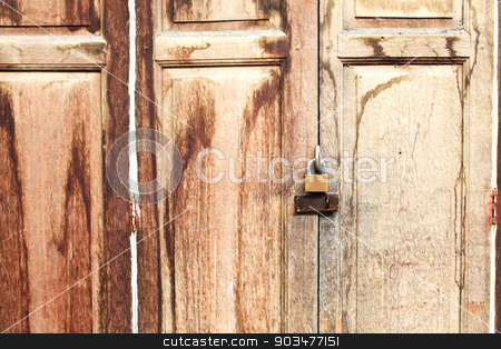 Lock on old wooden door. stock photo, Lock on old wooden door. by doraclub