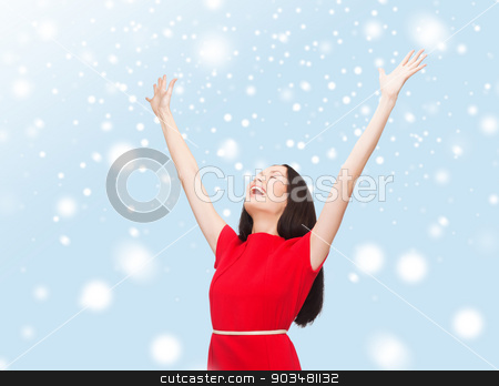 smiling young woman in red dress waving hands stock photo, happiness and people concept - smiling young woman in red dress waving hands with closed eyes by Syda Productions
