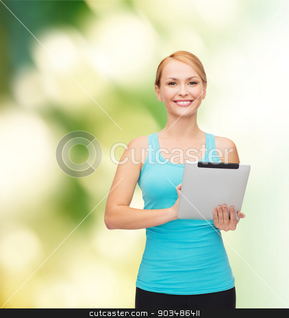 sporty woman with tablet pc stock photo, sport, excercise, technology, internet and healthcare - sporty woman with tablet pc by Syda Productions