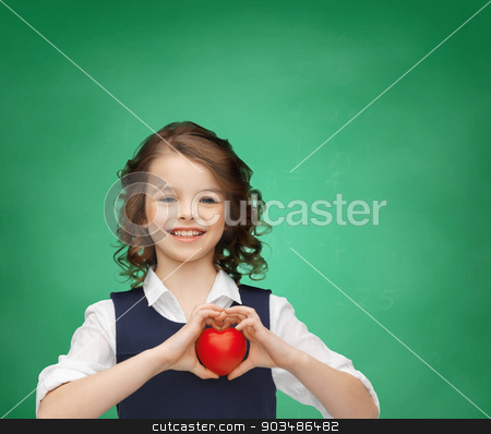 girl with small heart stock photo, love, educatioan and school concept - beautiful girl with small heart by Syda Productions
