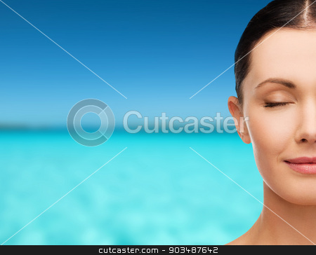 young calm woman with closed eyes stock photo, health, spa and beauty concept - clean face of beautiful young woman with closed eyes by Syda Productions