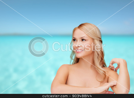 woman touching her shoulder skin stock photo, health and beauty concept - face of beautiful woman touching her shoulder skin by Syda Productions