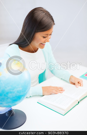 female teacher with globe and book stock photo, education and school, travel concept - female teacher with globe and book by Syda Productions